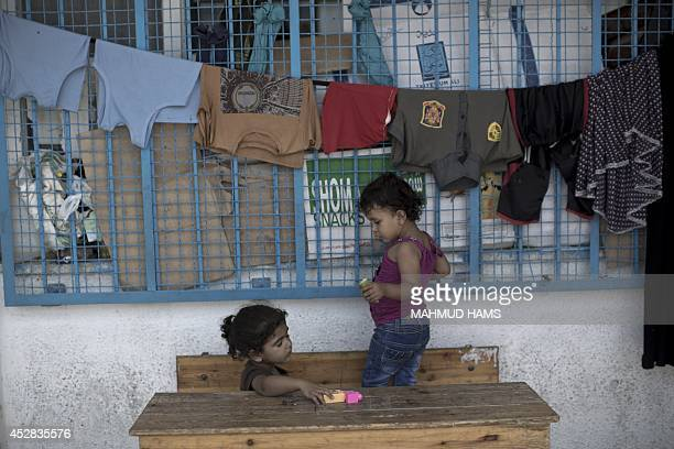 Displaced Palestinian children play at an United Nations school in Jabalia in the northern Gaza Strip where they found refugee with their family...