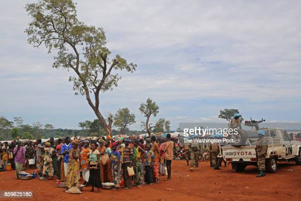 Displaced people wait for rations in Bria Central African Republic on September 26 2017