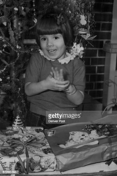 Displaced Persons 'It's Wonderful' Little 4yearold Liliana claps her hands in the great excitement of experiencing her first Christmas Credit Denver...