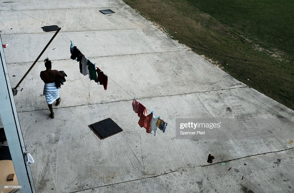 A displaced resident from the island of Barbuda does laundry at a shelter at a cricket stadium on December 7, 2017 in St John's, Antiqua. Barbuda, which covers only 62 square miles, was nearly leveled when Hurricane Irma made landfall with 185mph winds on the night of September 6. Only two days later, fearing Barbuda would be hit again by Hurricane Jose, the prime minister ordered an evacuation of all 1,800 residents of the island. Most are now still in shelters scattered around Barbuda's much larger sister island Antigua.