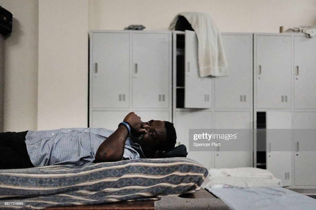 A displaced resident from the island of Barbuda sits inside a shelter at a cricket stadium on December 7, 2017 in St John's, Antiqua. Barbuda, which covers only 62 square miles, was nearly leveled when Hurricane Irma made landfall with 185mph winds on the night of September 6. Only two days later, fearing Barbuda would be hit again by Hurricane Jose, the prime minister ordered an evacuation of all 1,800 residents of the island. Most are now still in shelters scattered around Barbuda's much larger sister island Antigua.