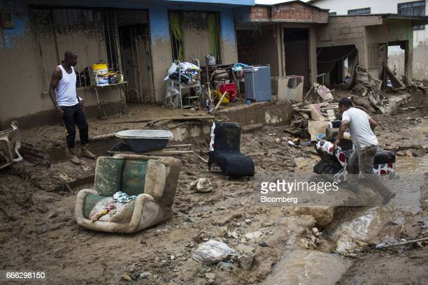 Displaced resident move destroyed furniture after a landslide in the Paolo VI neighborhood of Mocoa Putumayo Colombia on Monday April 3 2017...