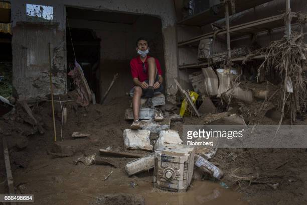 A displaced resident sits in a destroyed home in the Prospero neighborhood of Mocoa Putumayo Colombia on Monday April 3 2017 Torrential rains caused...