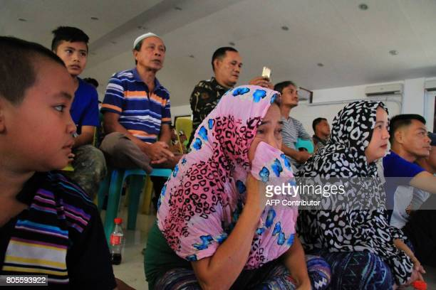 Displaced residents and soldiers watch the World Boxing Organisation welterweight boxing match between Manny Pacquiao of the Philippines and...