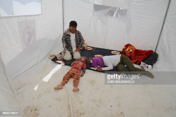 TOPSHOT Displaced residents from nearby communities affected by the floods rest at a refugee camp on the outskirts of the northern Peruvian city of...
