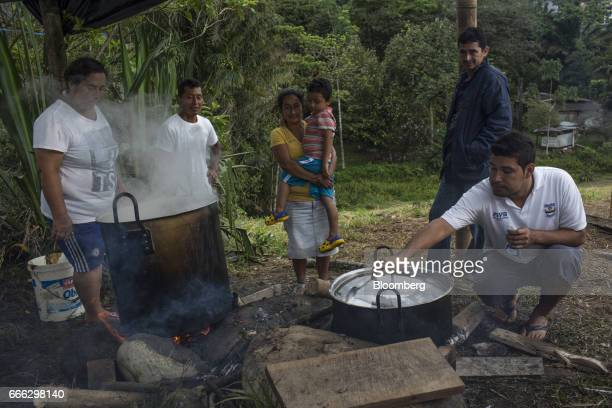 Displaced residents gather around a community kitchen after a landslide in the Miraflores neighborhood of Mocoa Putumayo Colombia on Monday April 3...