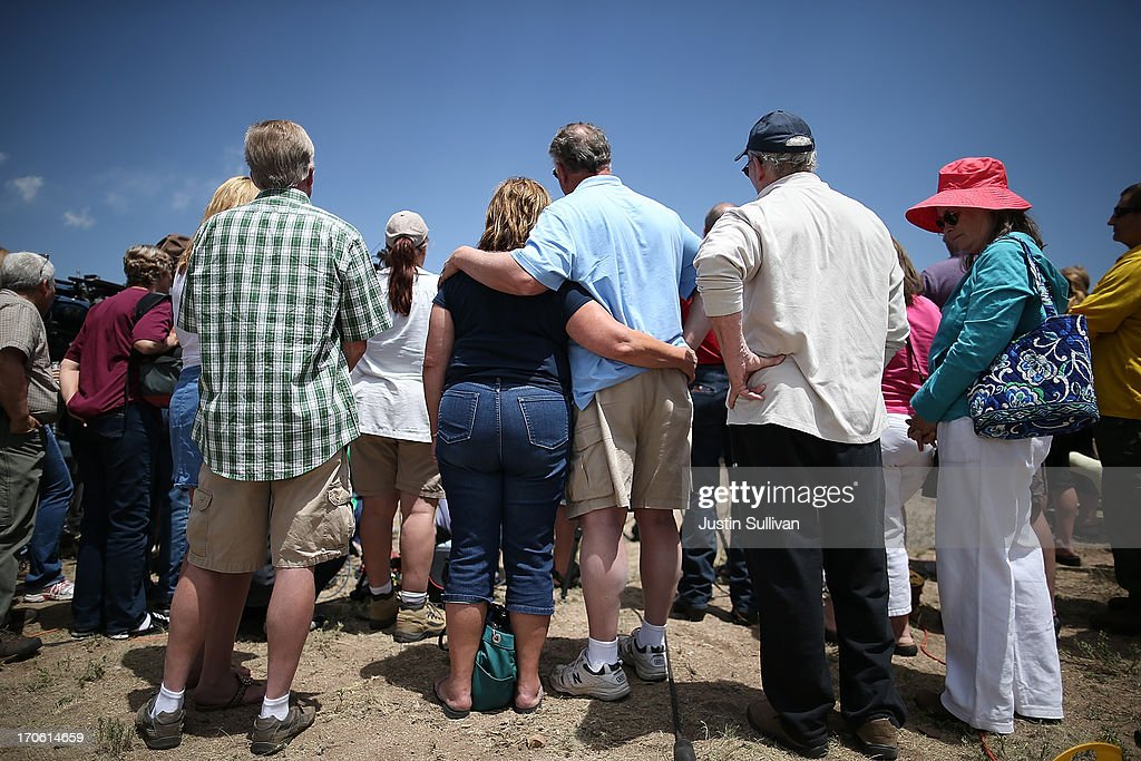 Displaced residents look on during a press conference with El Paso County sheriff Terry Maketa on June 15, 2013 in Colorado Springs, Colorado. The Black Forest fire is the most destructive in Colorado history, having consumed more than 15,000 acres as of this morning while destroying 473 homes. The fire is 45 percent contained. Two people have died in the fire.