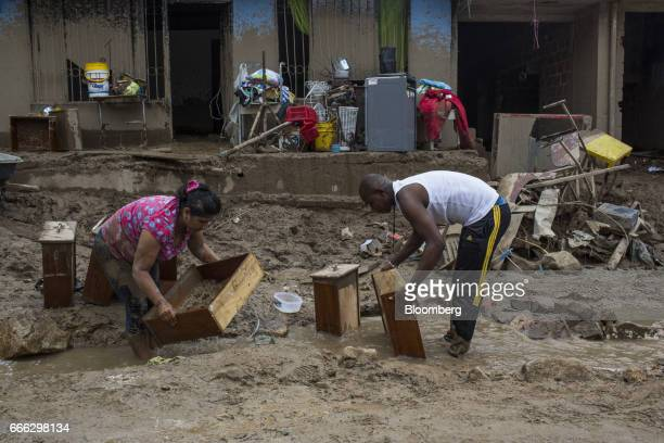 Displaced residents sift through belongings after a landslide in the Paolo VI neighborhood of Mocoa Putumayo Colombia on Monday April 3 2017...