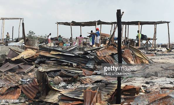 Displaced residents stand near makeshift structures demolished by the authorities at Otodo Gbame waterfront fishing communities in Lagos on November...