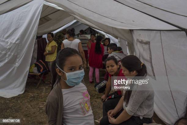 Displaced residents wait at a disaster relief center after a landslide in Mocoa Putumayo Colombia on Monday April 3 2017 Torrential rains caused...
