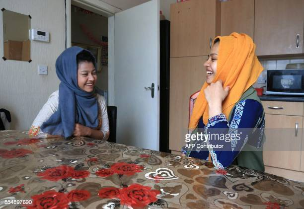 Displaced Rohingya community member Shahina Akter sits with her sister Omme Kulsum in their family home in Bradford west Yorkshire on September 27...