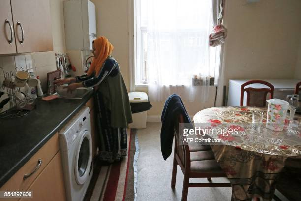 Displaced Rohingya community member Shahina Akter works in the kitchen of her family home in Bradford west Yorkshire on September 27 2017 For members...