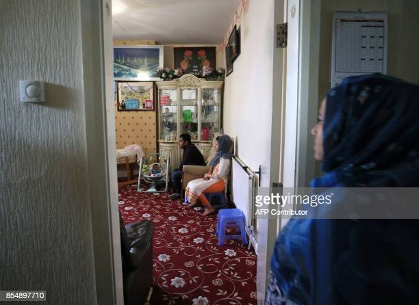 Displaced Rohingya community members Omme Kulsum and Samuda Harun are pictured in their family home in Bradford west Yorkshire on September 27 2017...