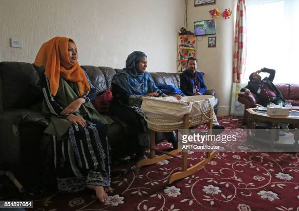 Displaced Rohingya community members Samuda Harun and Shahina Akter sit with Samuda's newborn baby in their family home in Bradford west Yorkshire on...