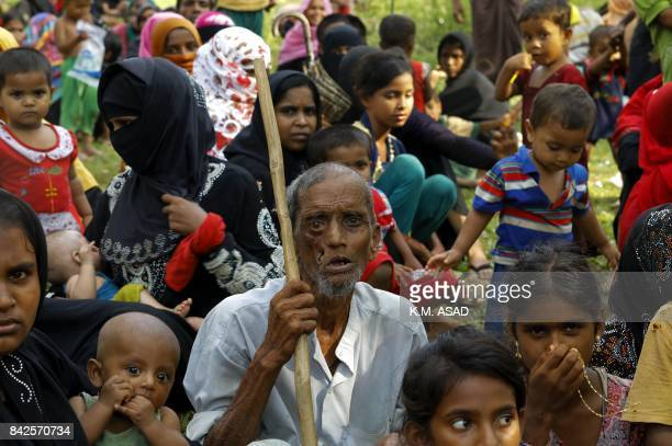 Displaced Rohingya refugees from Rakhine state in Myanmar rest near Ukhia near the border between Bangladesh and Myanmar as they flee violence on...