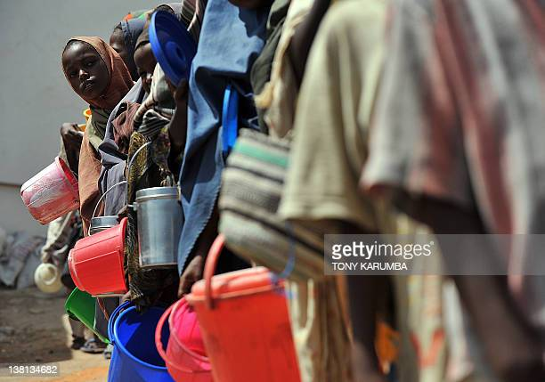 Displaced Somali children queue as they wait for foodaid rations on January 19 2012 at a distribution centre in Mogadishu Famine conditions have...