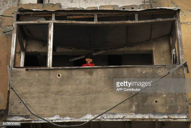 TOPSHOT A displaced Syrian child who fled the Islamic State group's Syrian stronghold of Raqa as fighters from a USbacked coalition battle to retake...
