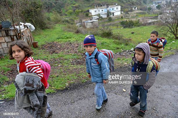 Displaced Syrian children return home after attending classes at a makeshift school in the Jabal alTurkman mountain area in Syria's northern Latakia...