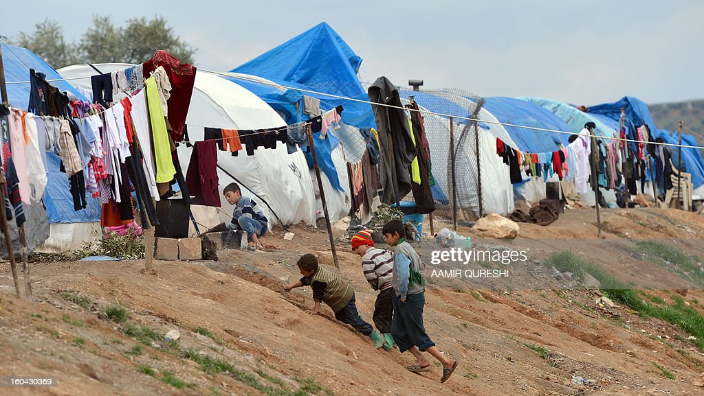 Displaced Syrian refugees play outside their tents at the refugee camp of Qah along the Turkish border in the village of Atme in the northwestern province of Idlib, on January 31 2012. Syria's main opposition group was to meet in Cairo, a day after a surprise statement from its chief that he was willing to hold talks with regime officials, a Syrian National Coalition member said.