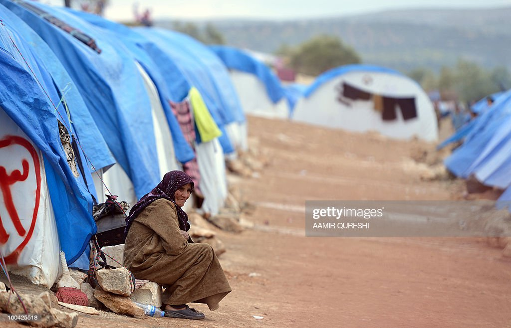 A Displaced Syrian woman sits outside their tents at the refugee camp of Qah along the Turkish border in the village of Atme in the northwestern province of Idlib, on January 31 2012. Syria's main opposition group was to meet in Cairo, a day after a surprise statement from its chief that he was willing to hold talks with regime officials, a Syrian National Coalition member said.