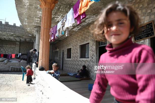 Displaced Syrians from the town of Maidaa play outside their home in the town of Mesraba in the eastern Ghouta region a rebel stronghold east of the...