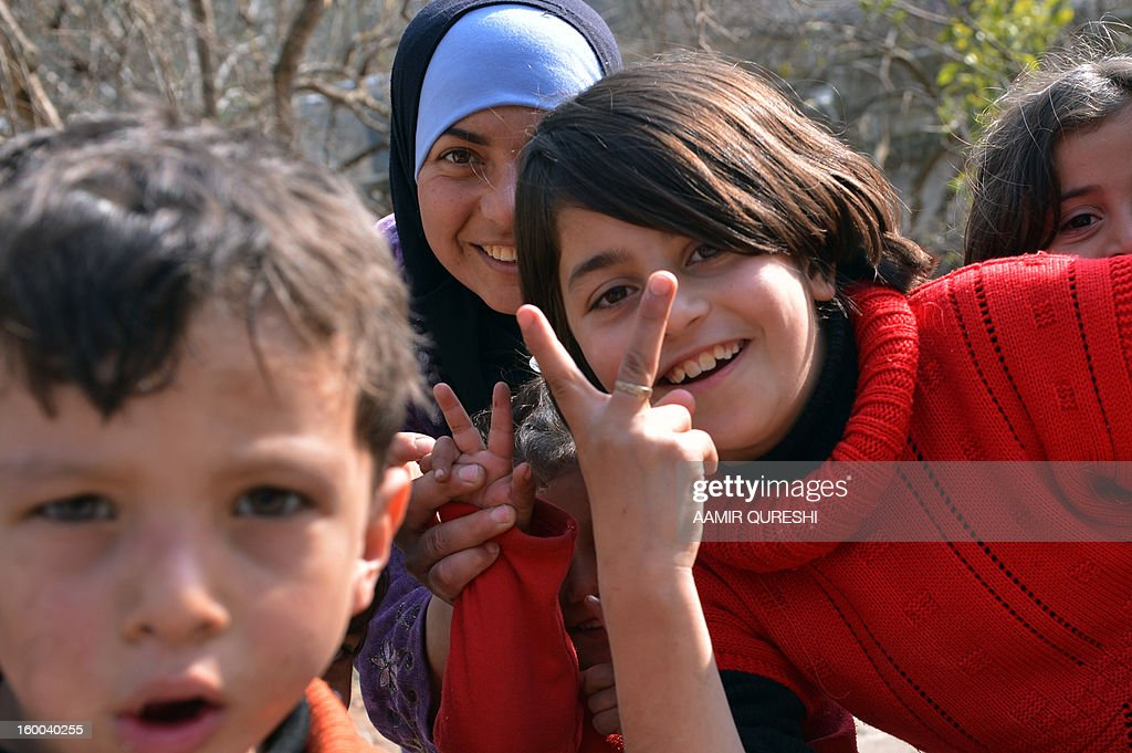 Displaced Syrians who fled their homes amid escalating violence make victory signs in the northern town of Darkush on January 25, 2013. More than 60,000 people have been killed in violence across Syria since an anti-regime revolt morphed into an armed insurgency after the regime of President Bashar al-Assad launched a brutal crackdown on dissent.