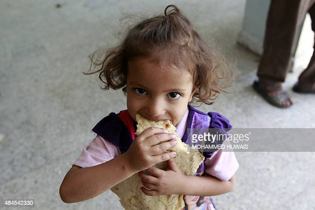 A displaced Yemeni child who fled Saada province with her family due to fighting between Shiite Huthi rebels and forces loyal to Yemen's exiled...