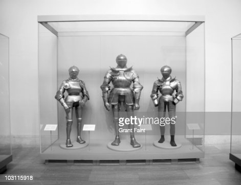 Display case of  various sizes of armoured suits