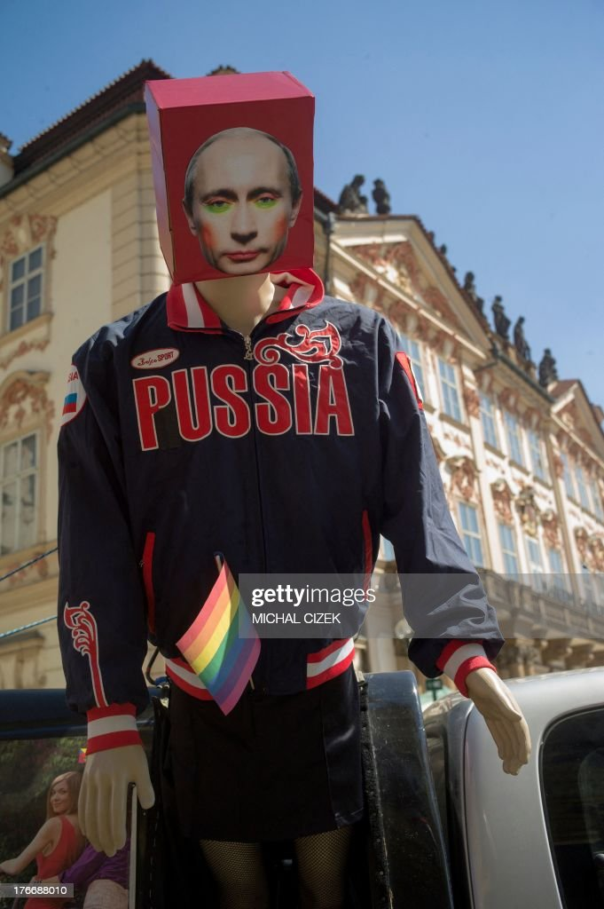 A display dummy with the portrait of the Russian President Vladimir Putin is fixed at a car during the third gay pride festival in the Czech capital Prague on August 17, 2013. AFP PHOTO / MICHAL CIZEK