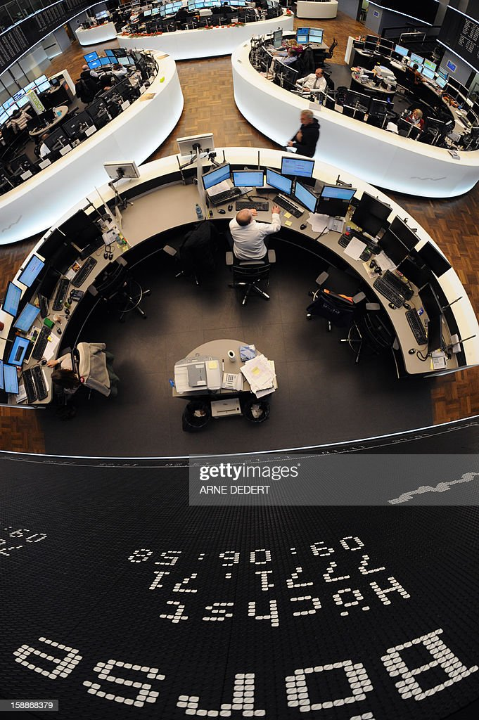 A display hangs at the trade room of the stock exchange in Frankfurt am Main, western Germany, on January 2, 2013. World stock markets surged, making a bright start to 2013, after the United States clinched a deal to avert the so-called 'fiscal cliff' of drastic tax rises and automatic spending cuts.