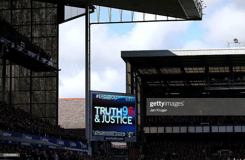 A display is seen on the big screen as family members of the victims of the Hillborough disaster join both teams on the pitch before the Barclays Premier League match between Everton and A.F.C. Bournemouth at Goodison Park on April 30, 2016 in Liverpool, England.