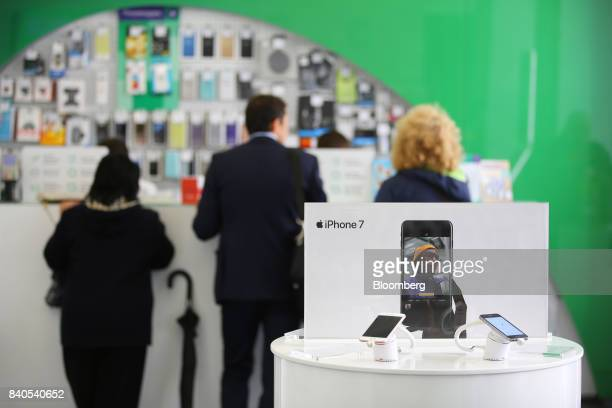 A display of Apple Inc iPhone 7 smartphones stands near the customer service desk inside a MegaFon PJSC mobile phone store in Moscow Russia on...