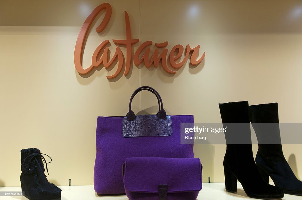 A display of Castaner fashion products, including handbags and shoes, sit for sale in the El Corte Ingles department store at Plaza Cataluna in Barcelona, Spain, on Wednesday, Nov. 21, 2012. Bank of Spain Governor Luis Maria Linde said the government risks missing its budget targets this year and next, adding to doubts on Prime Minister Mariano Rajoy's ability to cut the deficit amid a five-year slump. Photographer: Stefano Buonamici/Bloomberg via Getty Images
