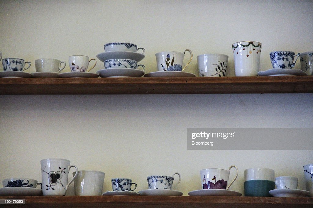 A display of Danish porcelain cups stand on display inside a Royal Copenhagen store on Storget street in Copenhagen, Denmark, on Friday, Feb. 1, 2013. Danish regional banks are struggling to emerge from a burst property bubble that's forced the government resolution agency to take over a dozen lenders after losses on commercial and agricultural loans wiped out capital. Photographer: Freya Ingrid Morales/Bloomberg via Getty Images