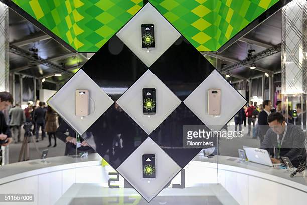 A display of LG Electronics Inc G5 smartphones hangs at a news conference ahead of the Mobile World Congress in Barcelona Spain on Sunday Feb 21 2016...