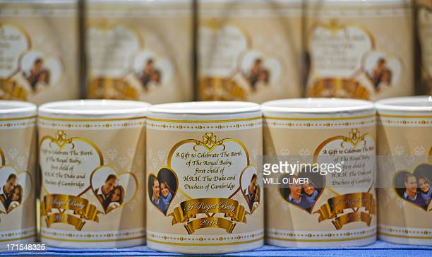 A display of mugs part of an assortment of souvenir gifts celebrating the upcoming birth of the royal baby of Prince William Duke of Cambridge and...