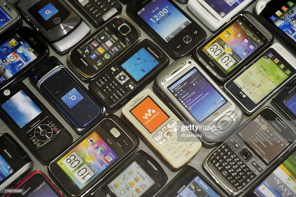 A display of old mobile phones is seen inside an O2 Mobile Phone Store, part of Telefonica SA, on Grafton Street in Dublin, Ireland, on Wednesday, June 12, 2013. Telefonica SA, Europe's most indebted telephone company, is seeking initial bids for its Irish unit within the month, two people with knowledge of the matter said. Photographer: Aidan Crawley/Bloomberg via Getty Images