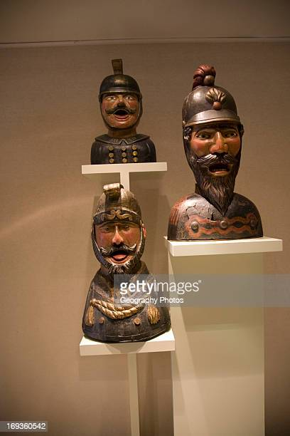 Display of old open mouthed gaper heads traditionally used to identify a pharmacy in Holland Zuiderzee museum Enkhuizen Netherlands