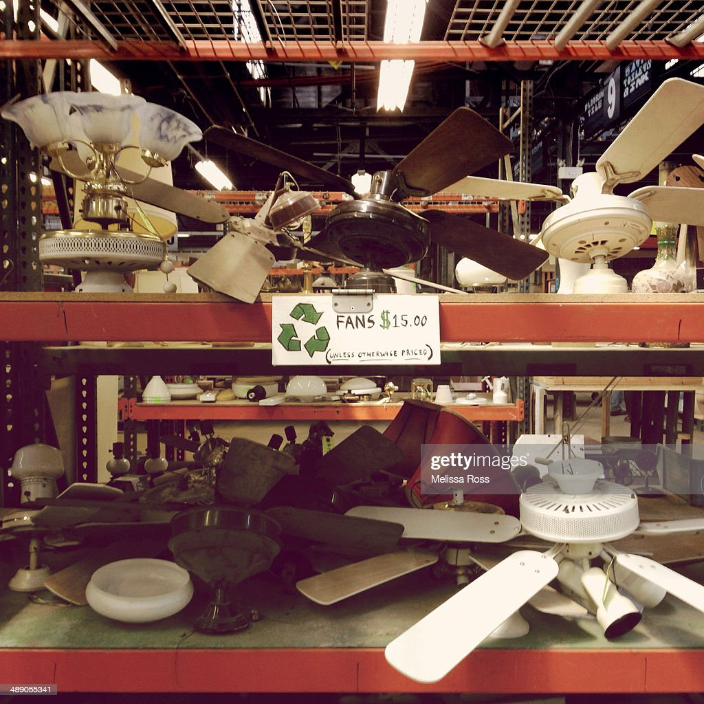 Display Of Old Used Ceiling Fans For Sale In A Salvage