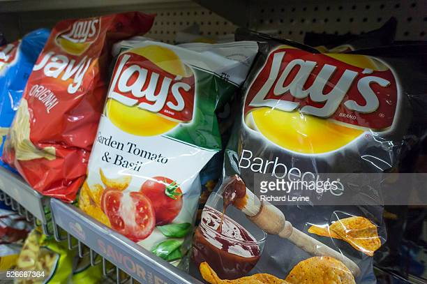 A display of PepsiCo FritoLay potato chip snacks in a supermarket in New York on Thursday February 12 2015 PepsiCo will report results for its...