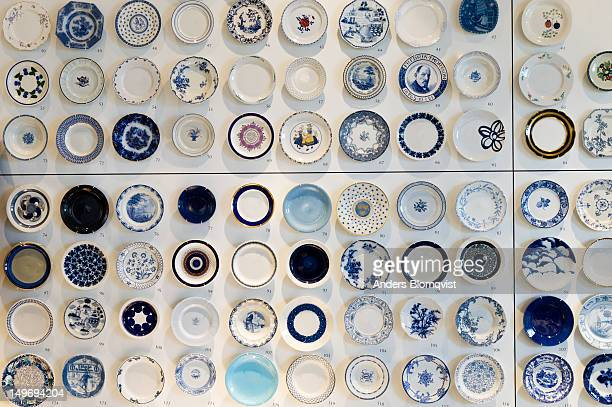 Display of porcelain plates at Rorstrand Museum.