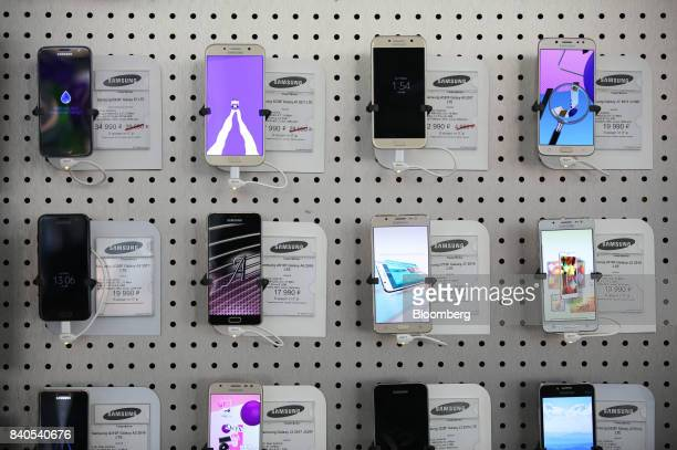 A display of Samsung Electronics Co smartphones sit on display inside a MegaFon PJSC mobile phone store in Moscow Russia on Tuesday Aug 29 2017...