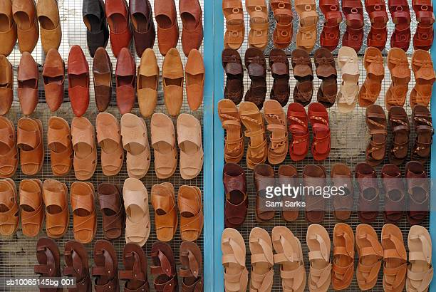 Display of slippers for sale at market (full frame)