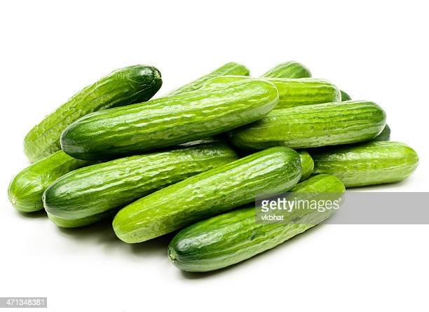 Display of small green cucumbers