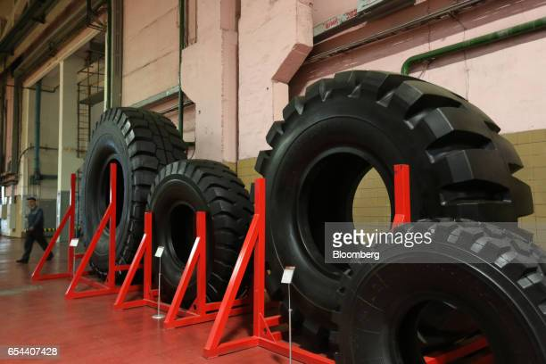 A display of superoversized rubber tires manufactured at the plant sit on display at the Belshina JSC tire factory in Babruysk Belarus on Thursday...