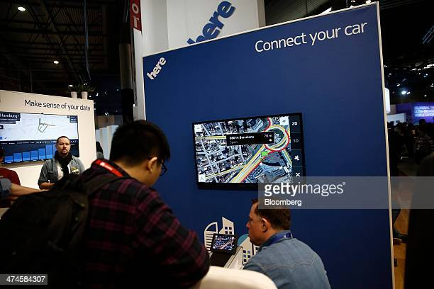 A display of the Nokia Oyj map application operated by the company's Here unit demonstrate its use inside vehicles on the opening day of the Mobile...