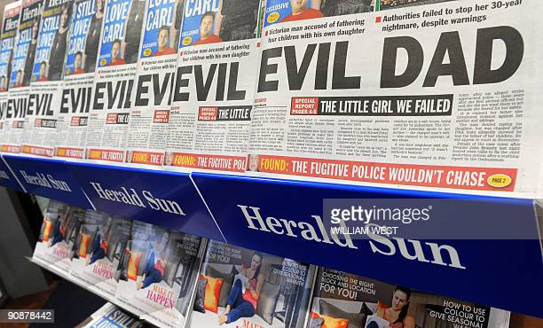 A display outside a Melbourne shop on September 17 shows rows of the morning newspaper The HeraldSun with the headline story of an Australian man...