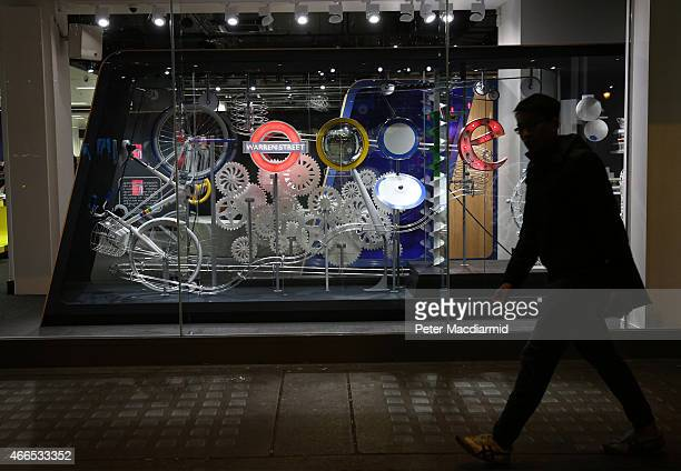 A display representing the Google name and logo is lit up at night in the window of a branch of PC World on March 16 2015 in London England Google's...