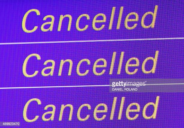 A display showing cancelled flights due to a strike of pilots of German airline Lufthansa is pictured at the airport in Frankfurt am Main Germany on...