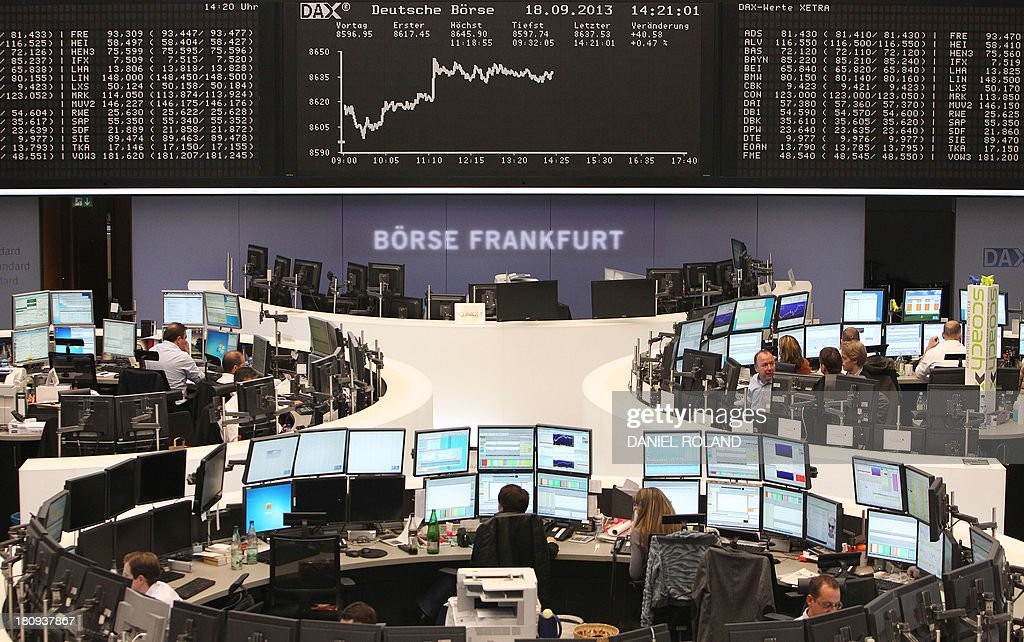 A display showing the German stock market index DAX is seen at the stock exchange in Frankfurt/Main, Germany, on September 18, 2013. AFP PHOTO / DANIEL ROLAND